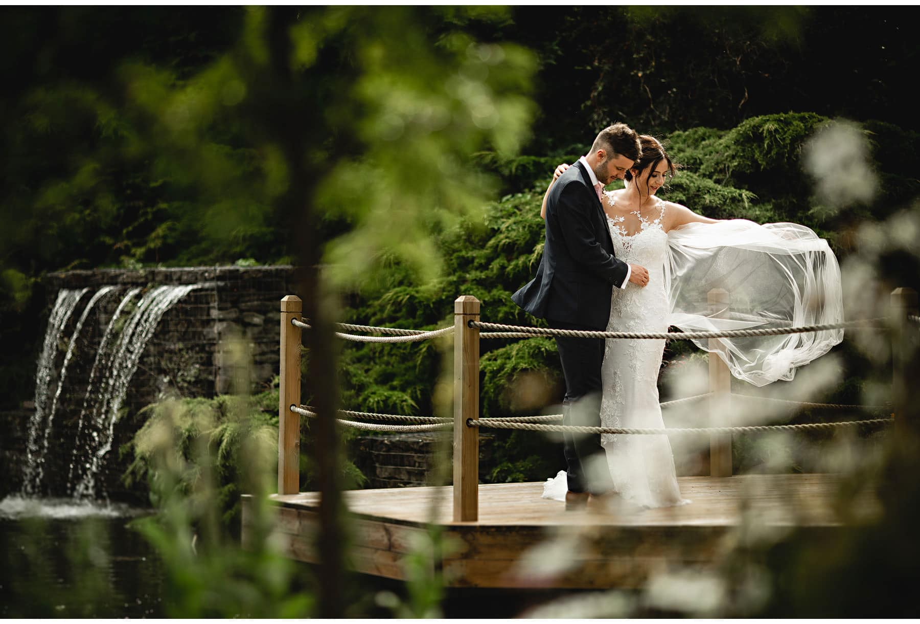 the bride & groom in the gardens at Redhouse Barns