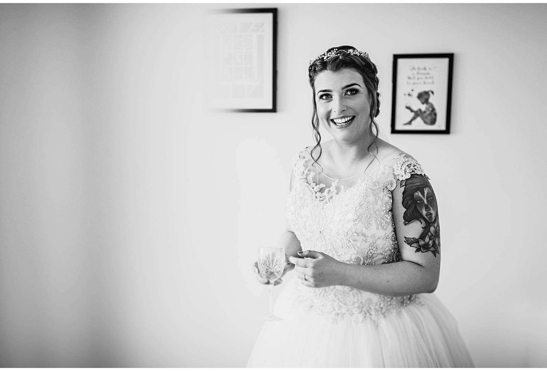 the bride in black and white looking happy