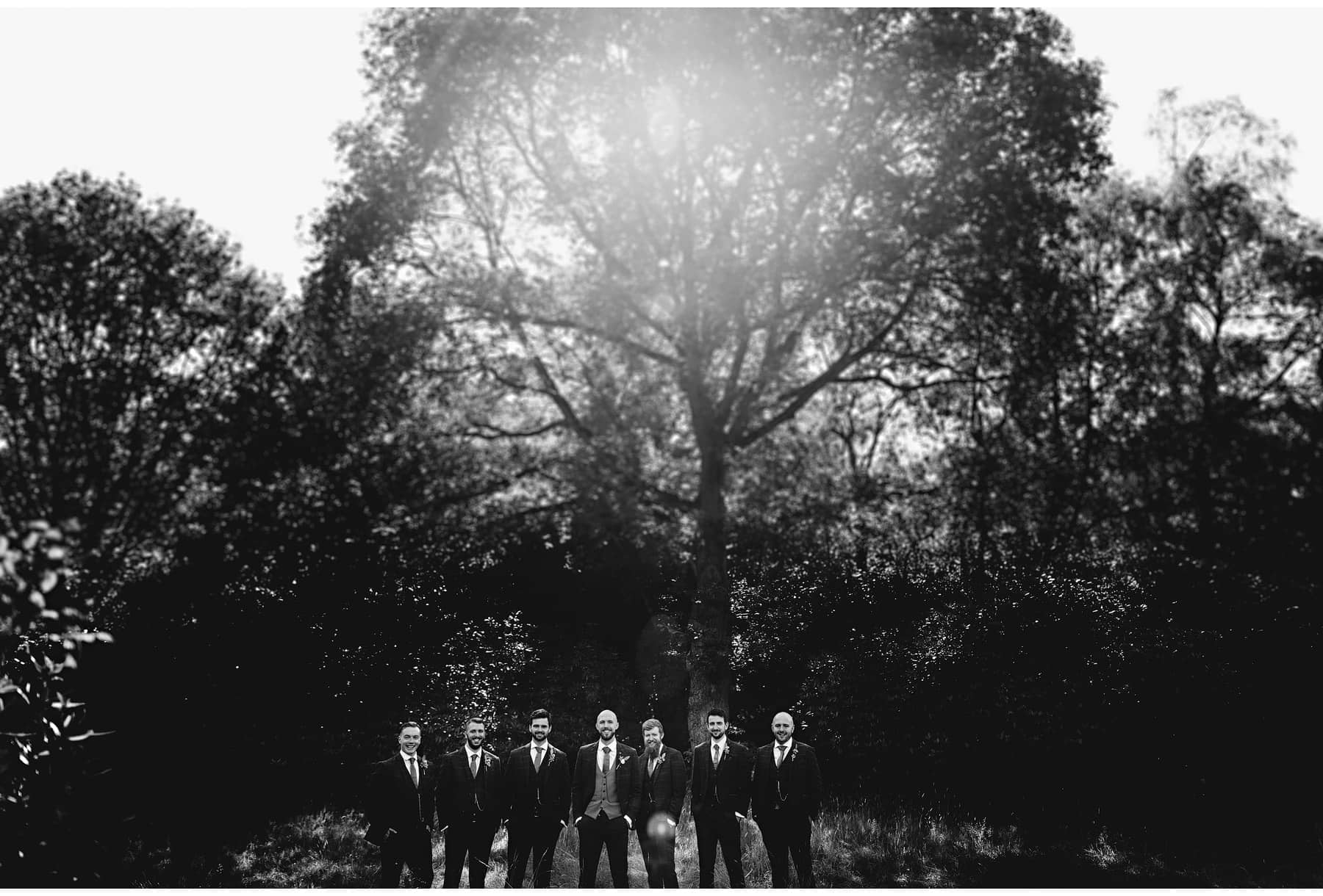 the groomsmen in black and white