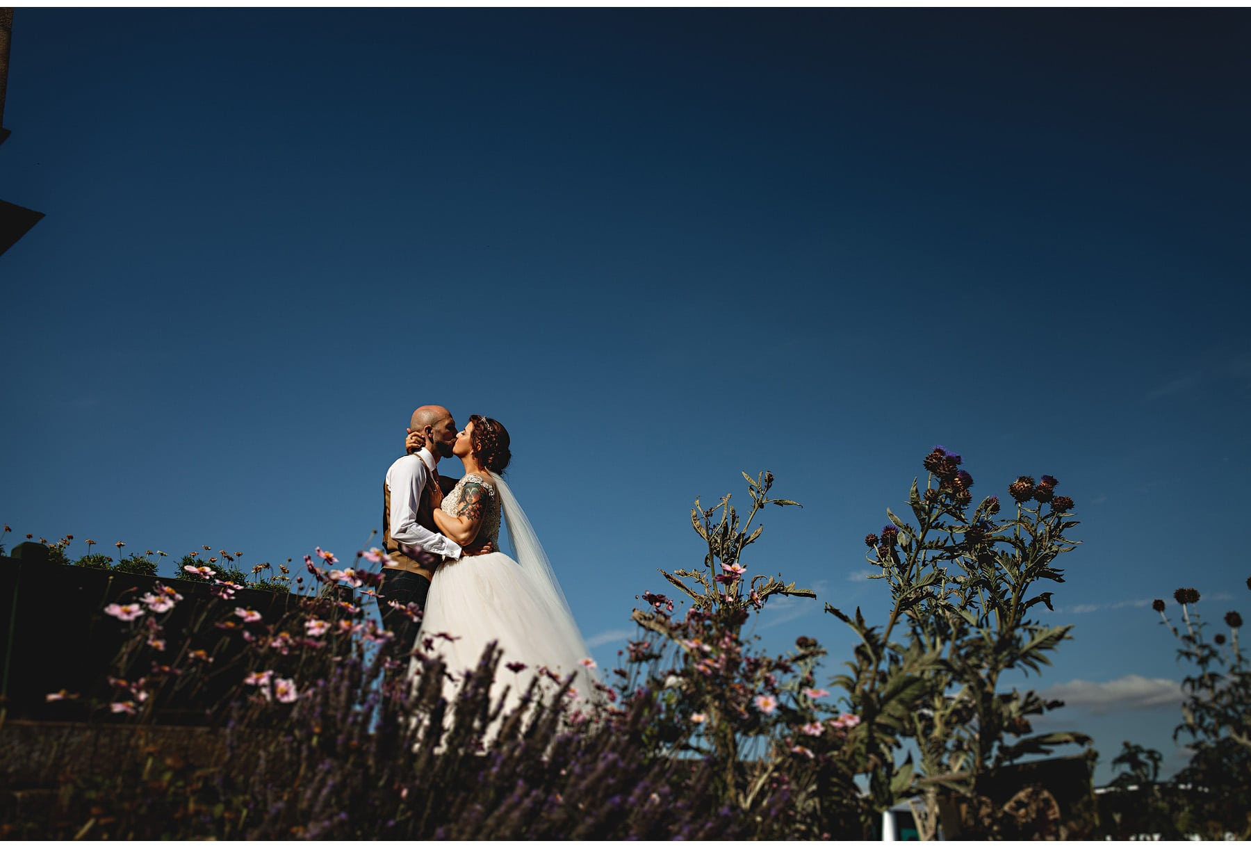 bride and groom  with blue skies