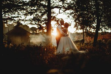 the bride and groom in golden sunlight in the evening at Wortley Hall on their wedding day
