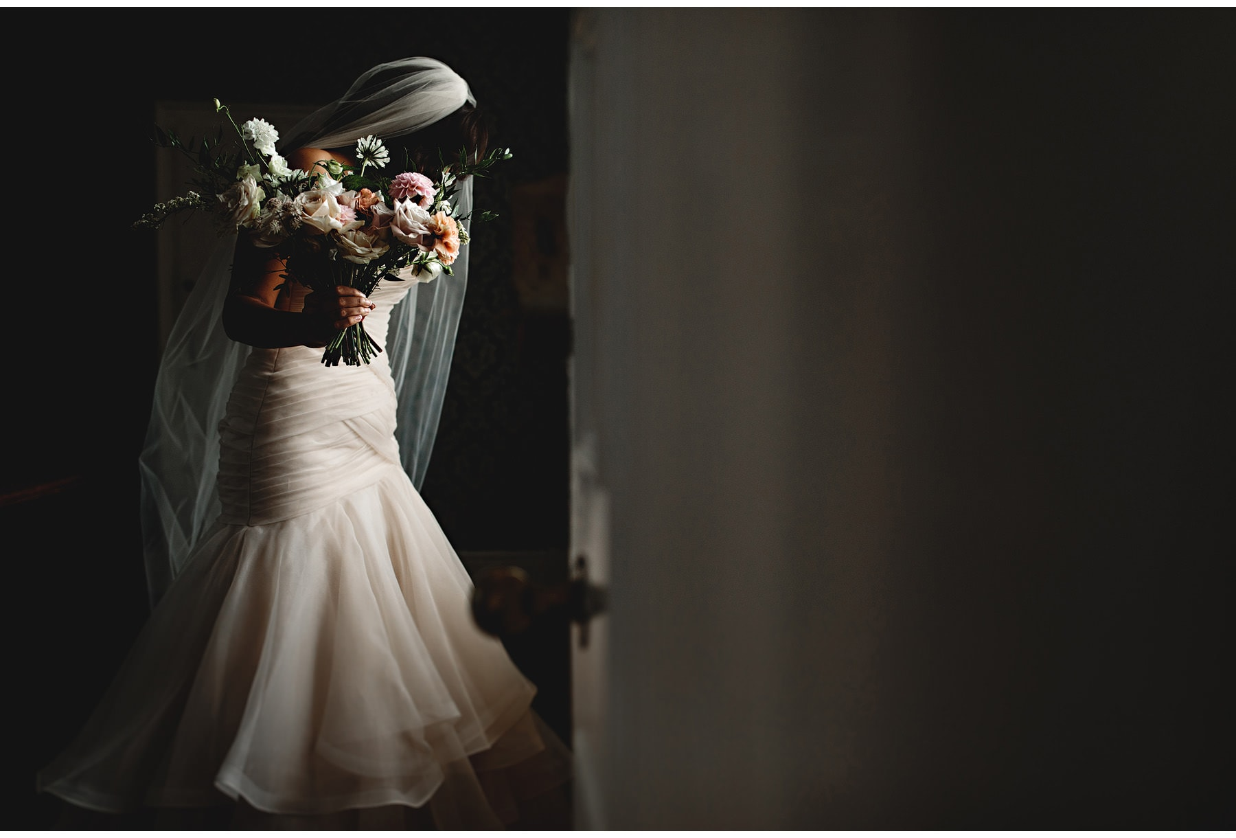 the bride holding her bourquet at Dunchurch Park