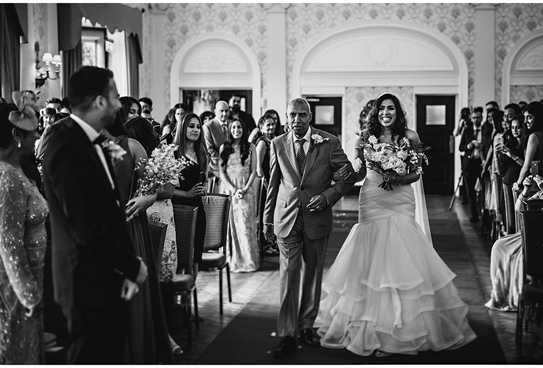 the bride and her dad walking down the aisle