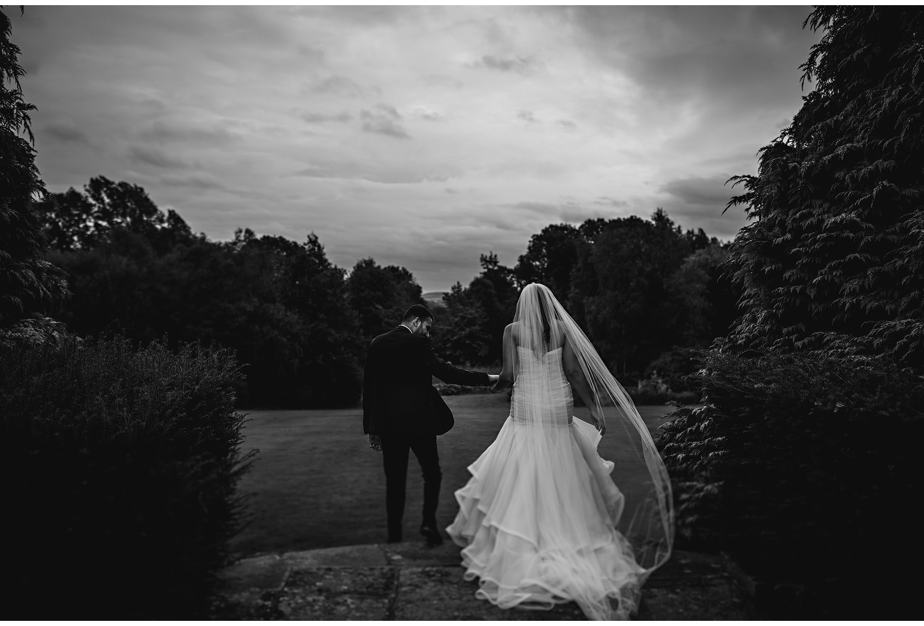 the bride & groom walking down the steps at Dunchurch Park