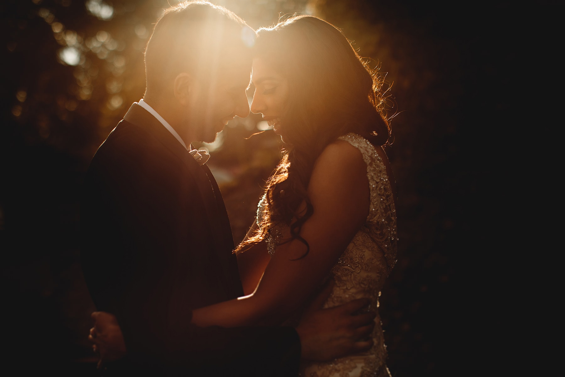 bride and groom in golden sunlight