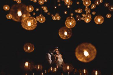 bride & groom amongst lots of lights