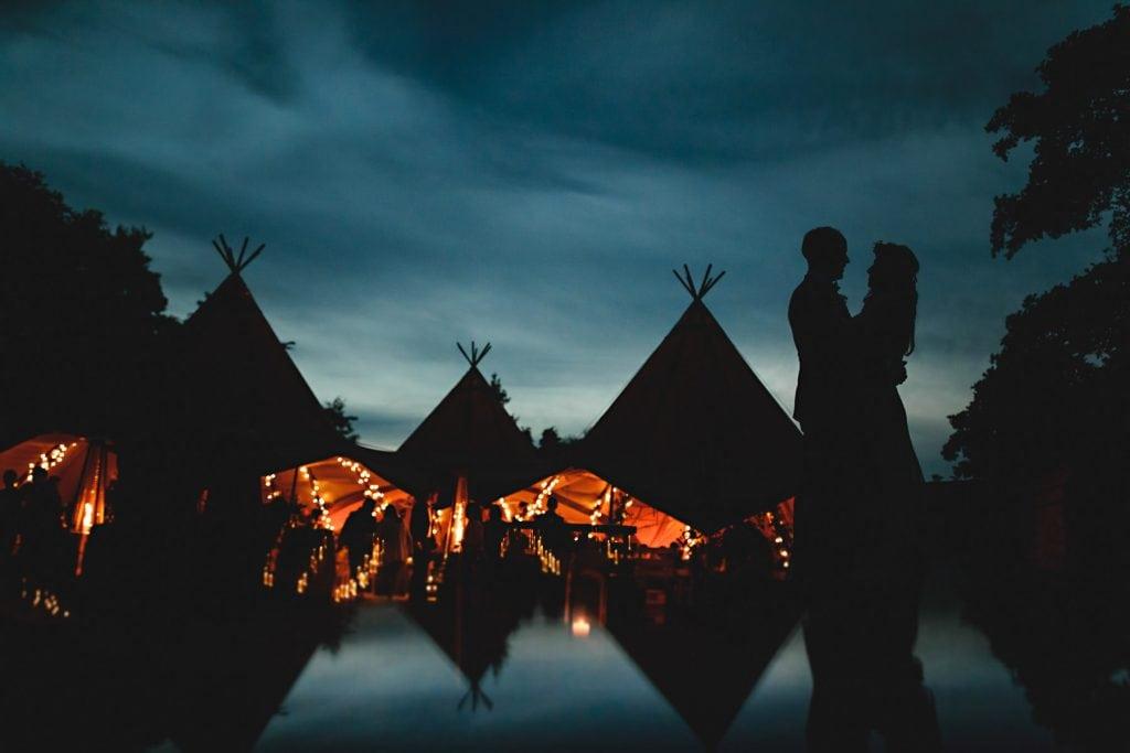 bride & groom in silhouette