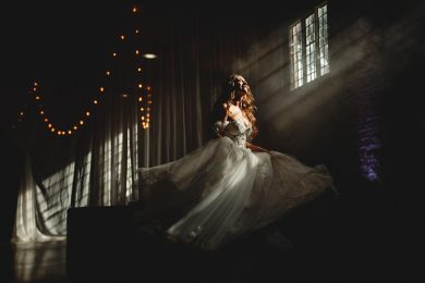 the bride twirling in the smokey light