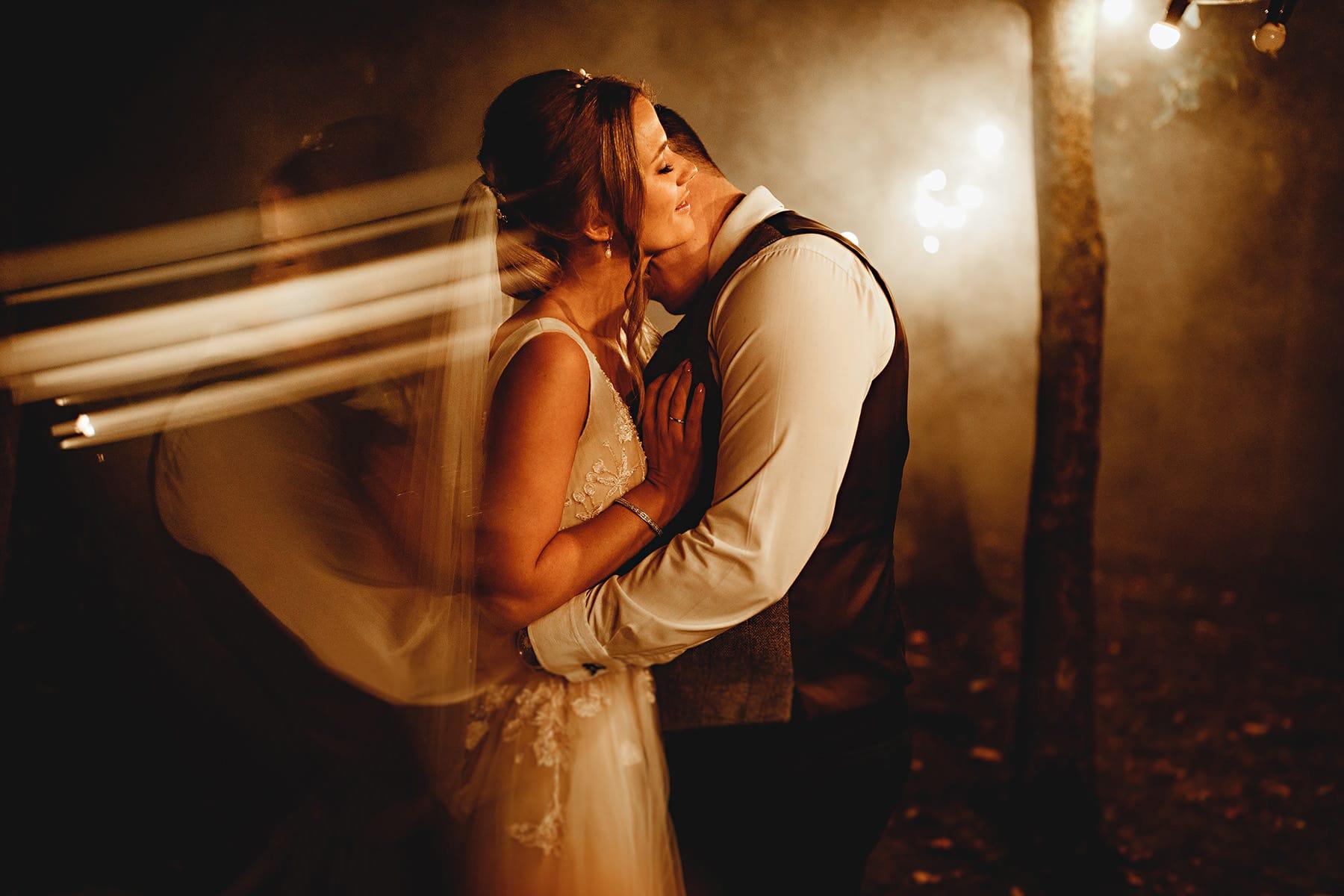 bride and groom hugging in the smoke at shustoke barns
