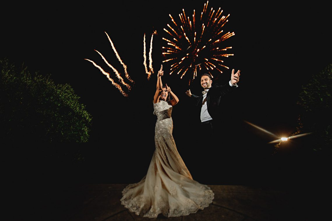bride and groom in the fireworks on their wedding day