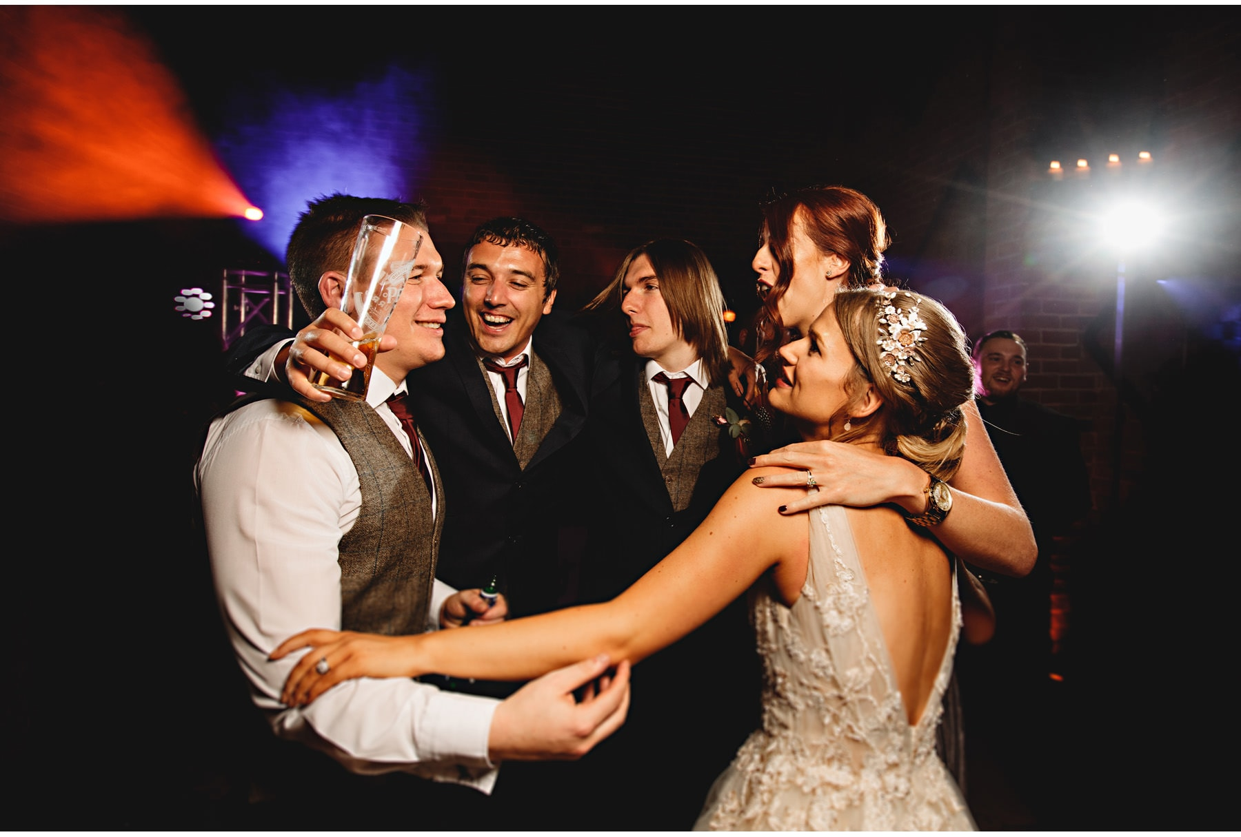the bride & groom on the dancefloor with their friends!