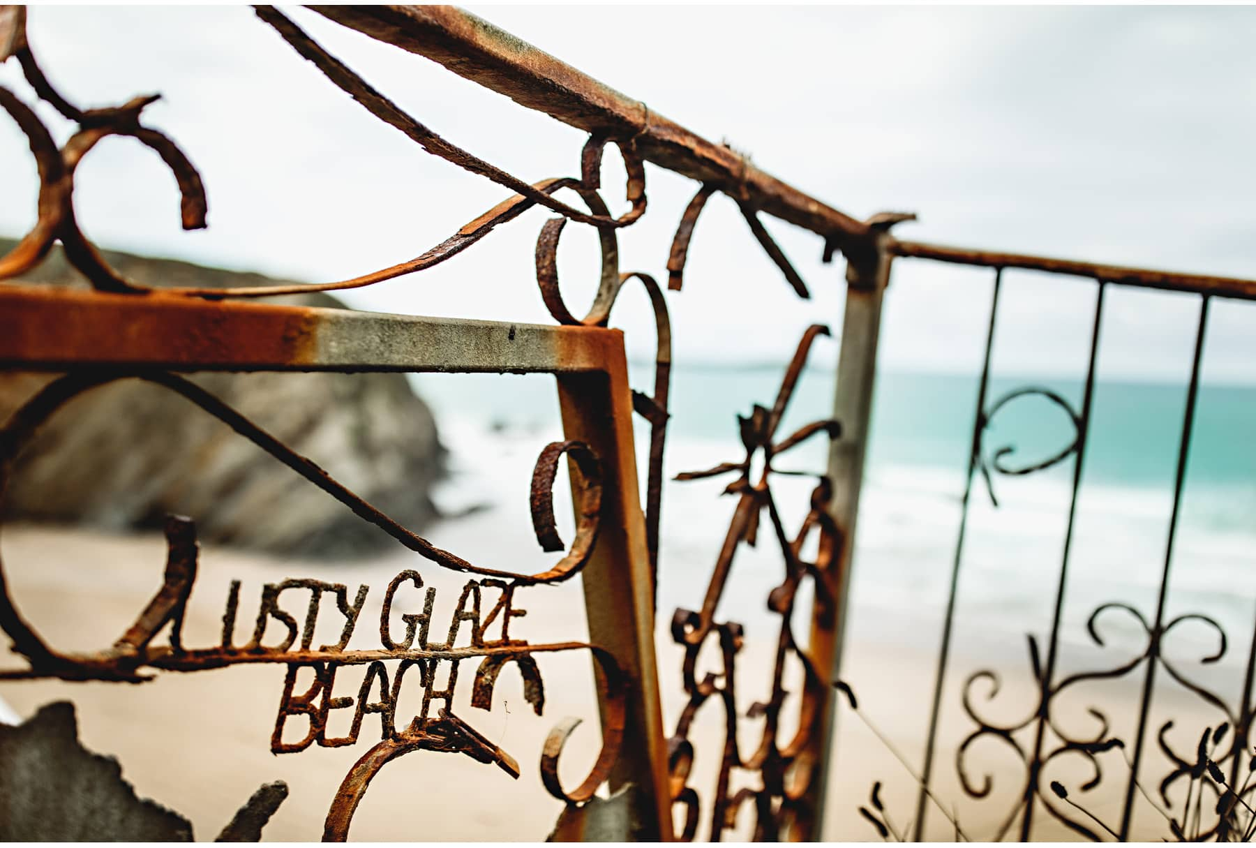 The Lusty Glaze sign made from rusty metal