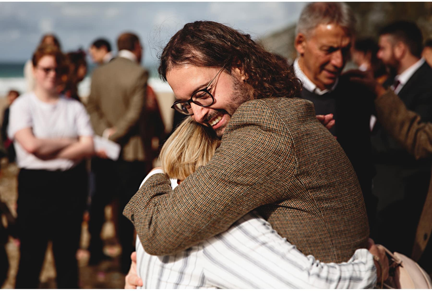 the groom hugging wedding guests