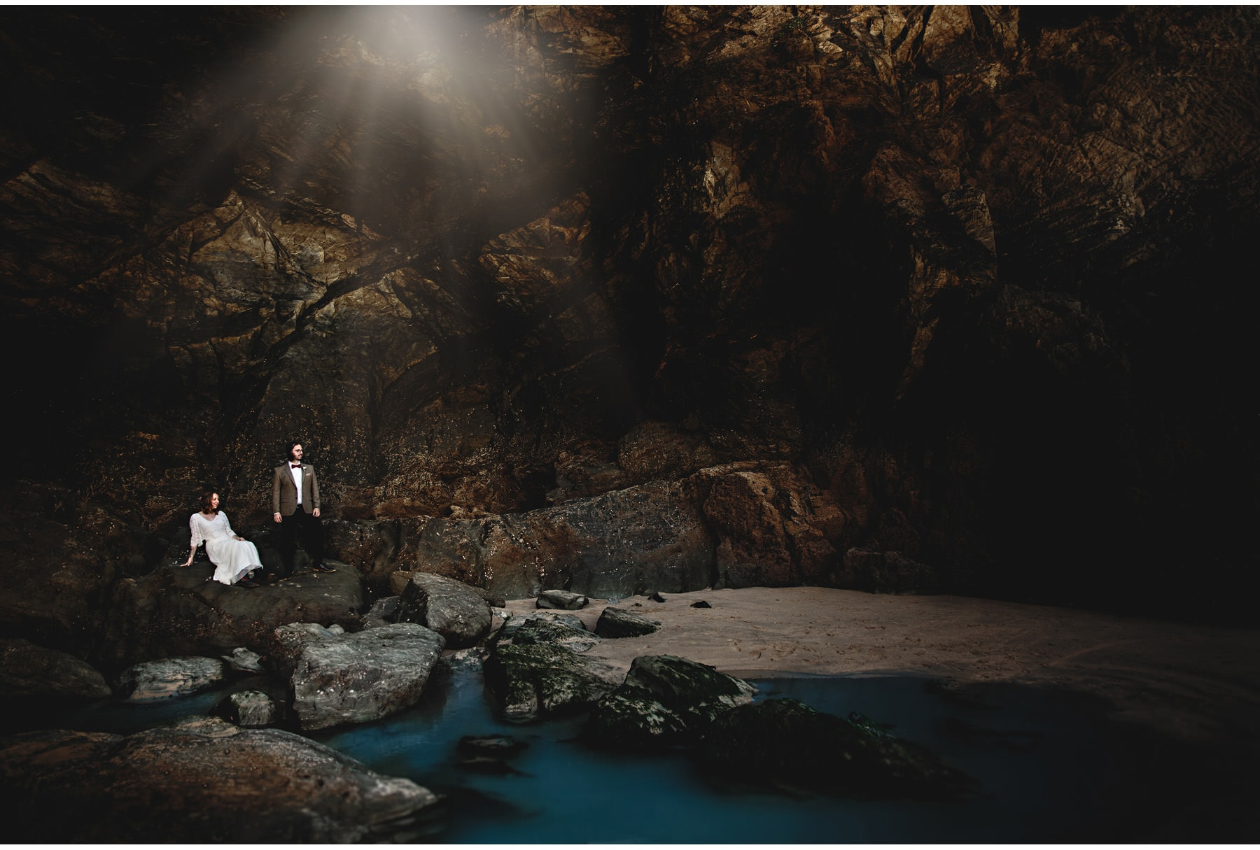 the bride & groom in a cave