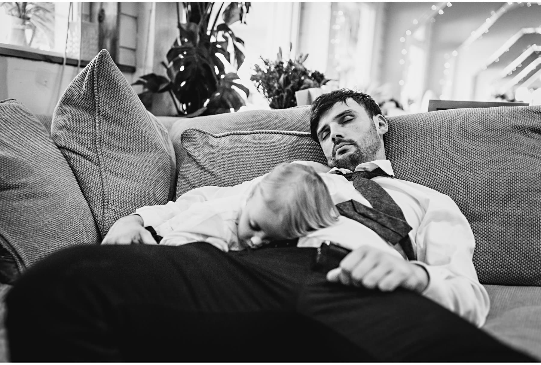 wedding guest and son asleep at the wedding