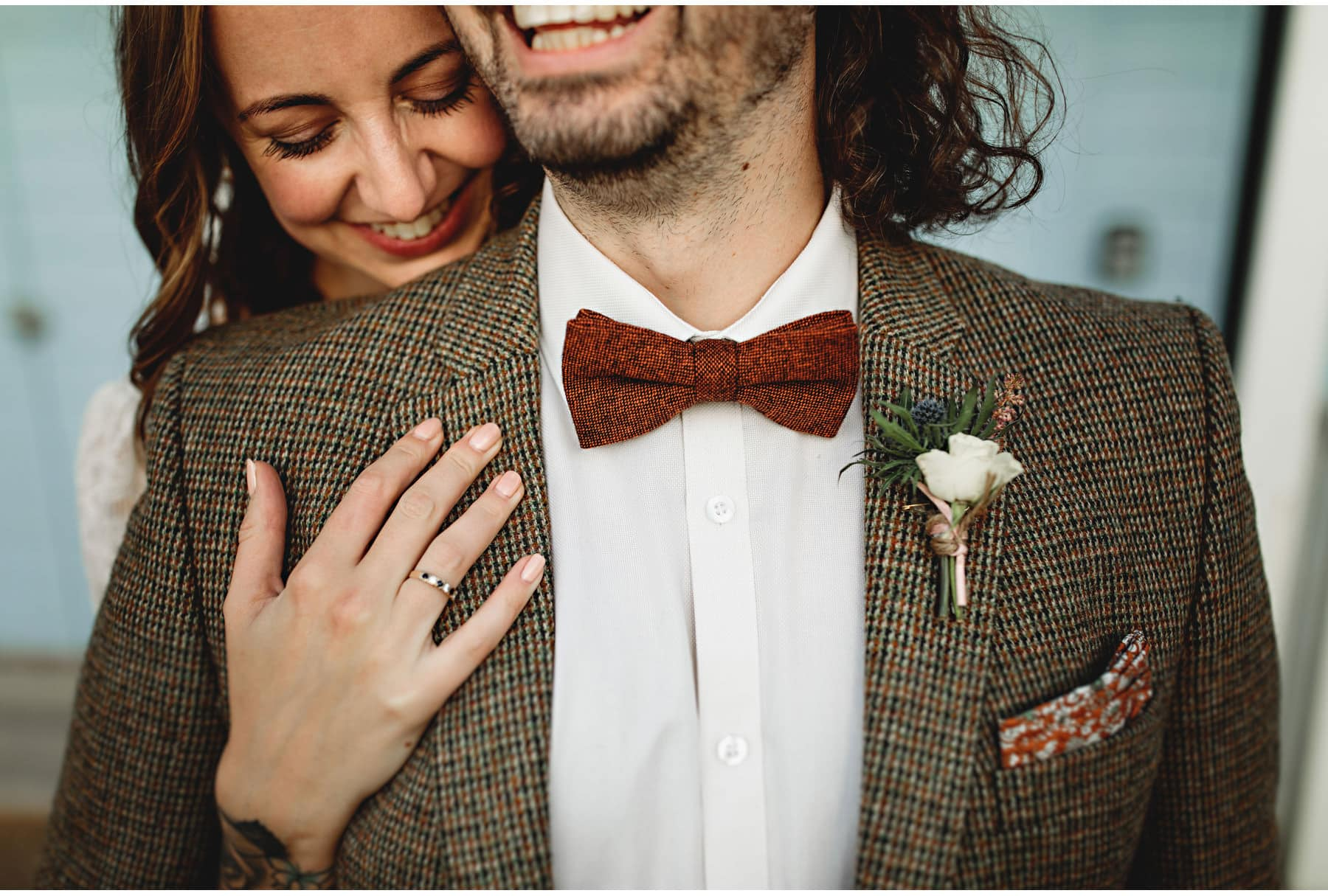 the groom's bow tie and buttonhole