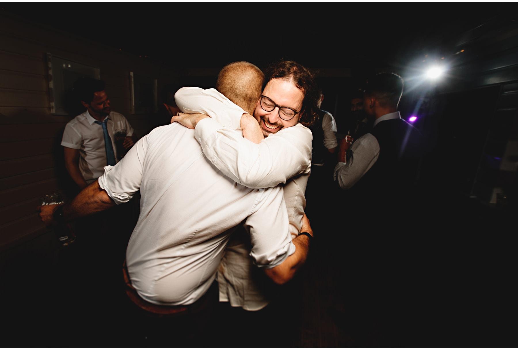 the groom hugging everyone