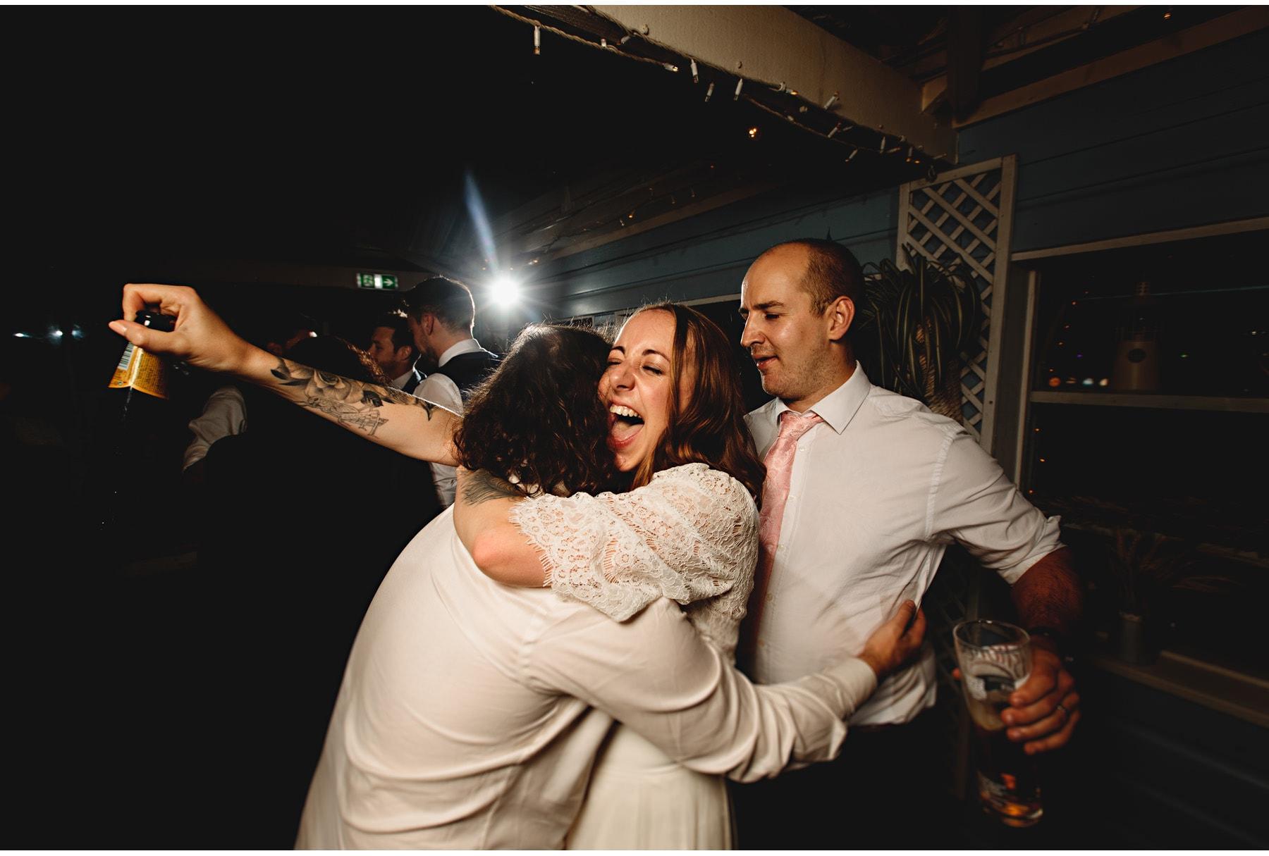 the bride hugging friends on the dancefloor