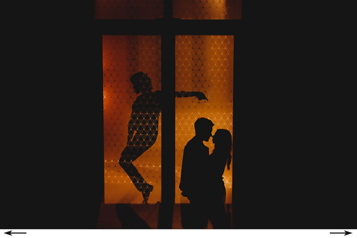 dancing under orange lights in silhouette