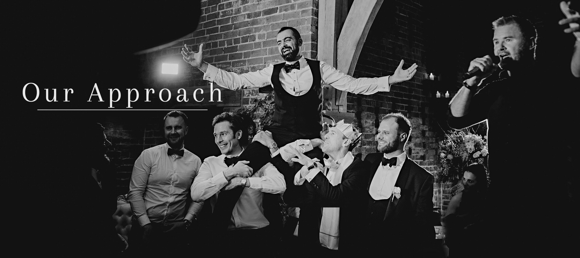 groom being liften into the air by his best men