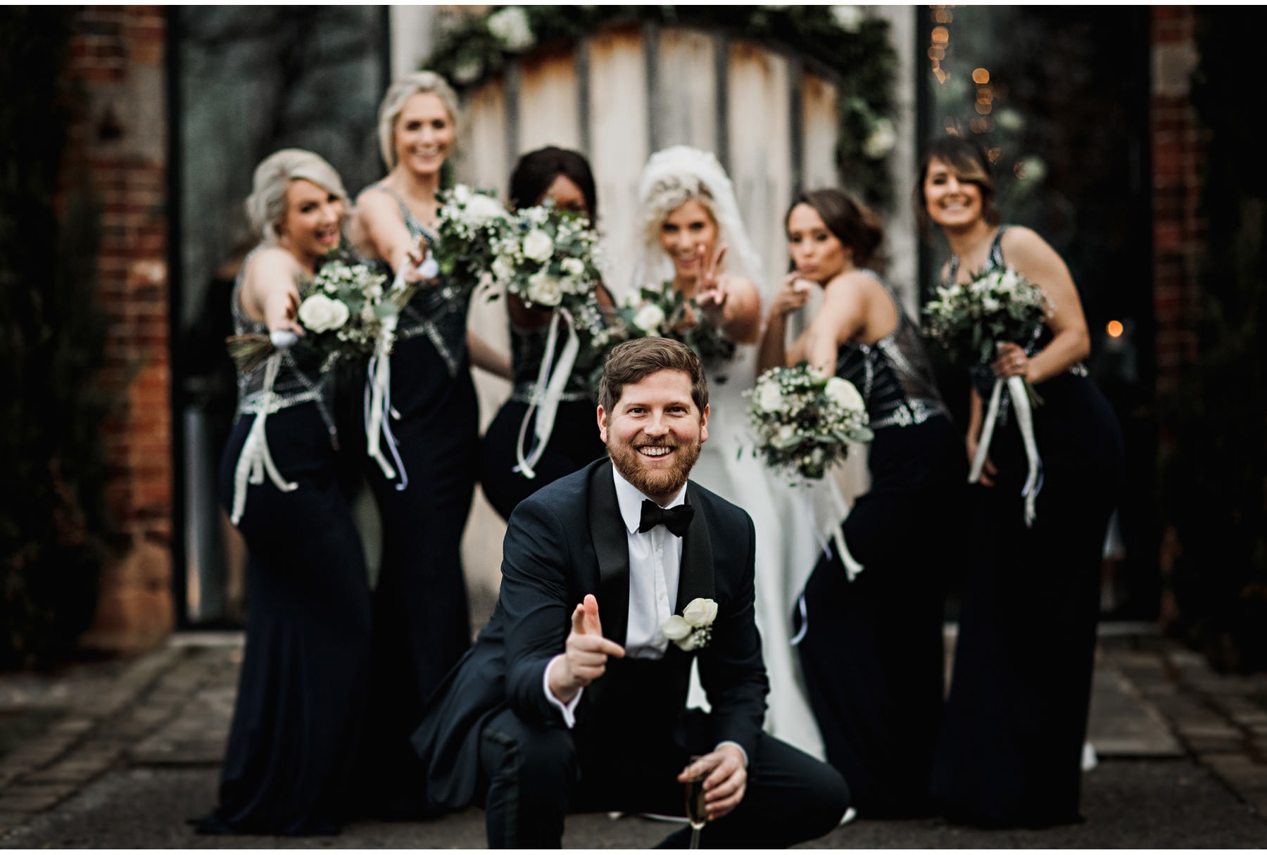 The bride, her brother and the bridesmaids