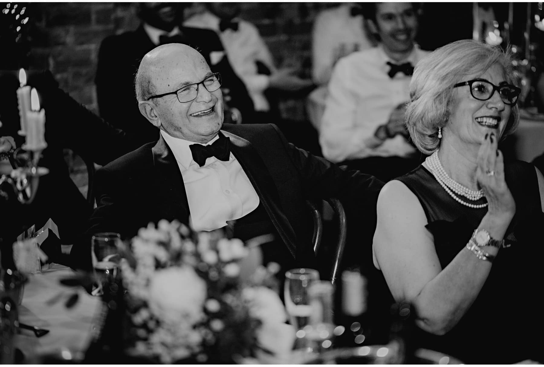 The groom's father laughing at speeches