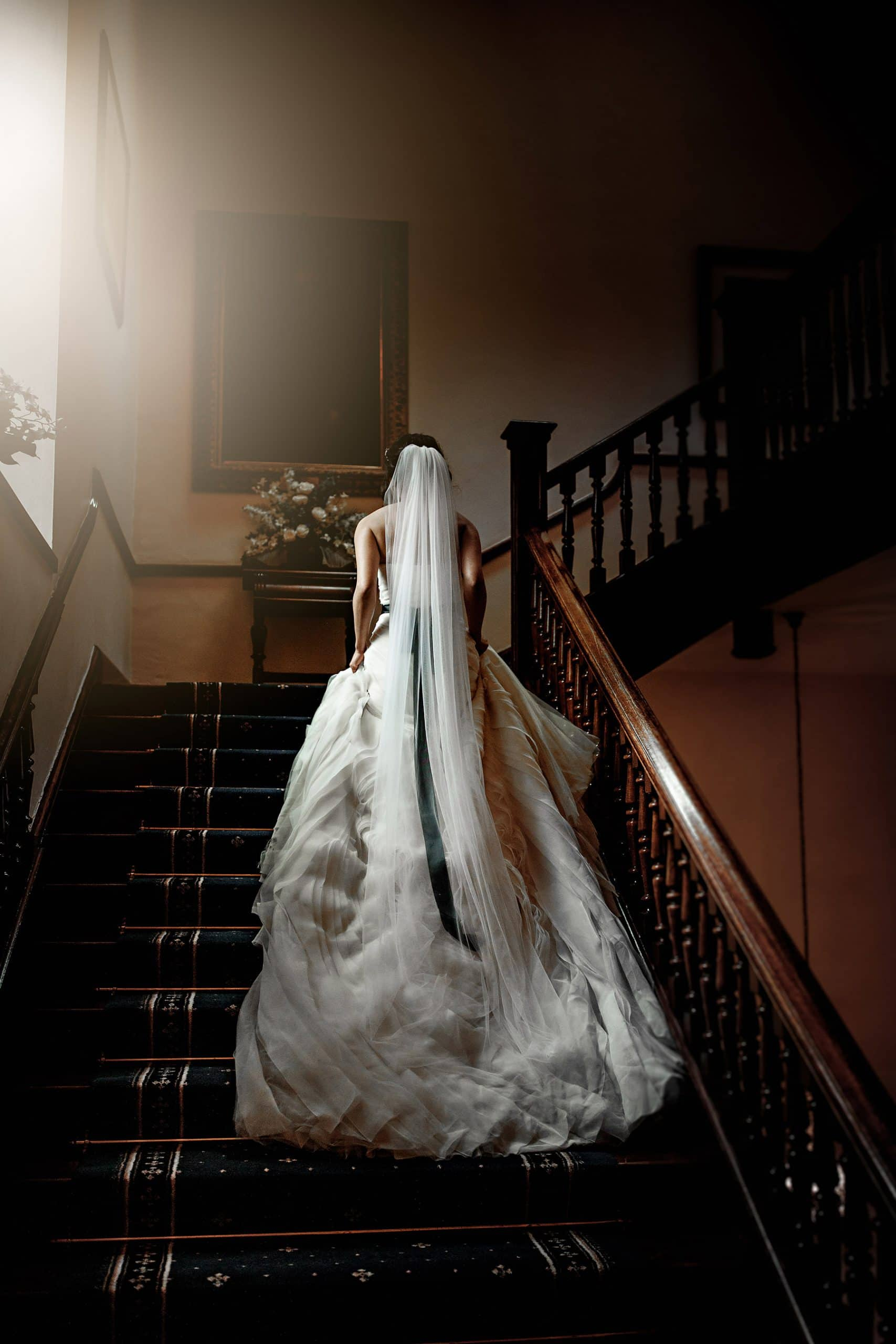 the bride walking up the staircase at clearwell castle