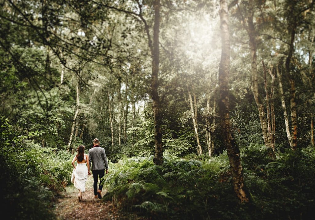 derbyshire wedding photographer following a bride and groom through the woods